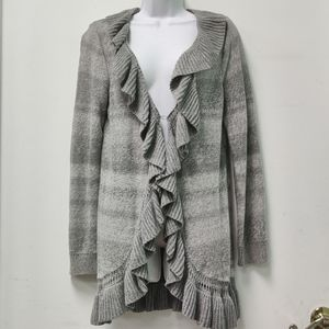 Open cardigan with ruffle detail.